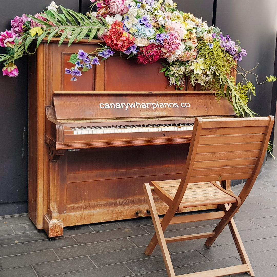 Canary Wharf piano with flowers